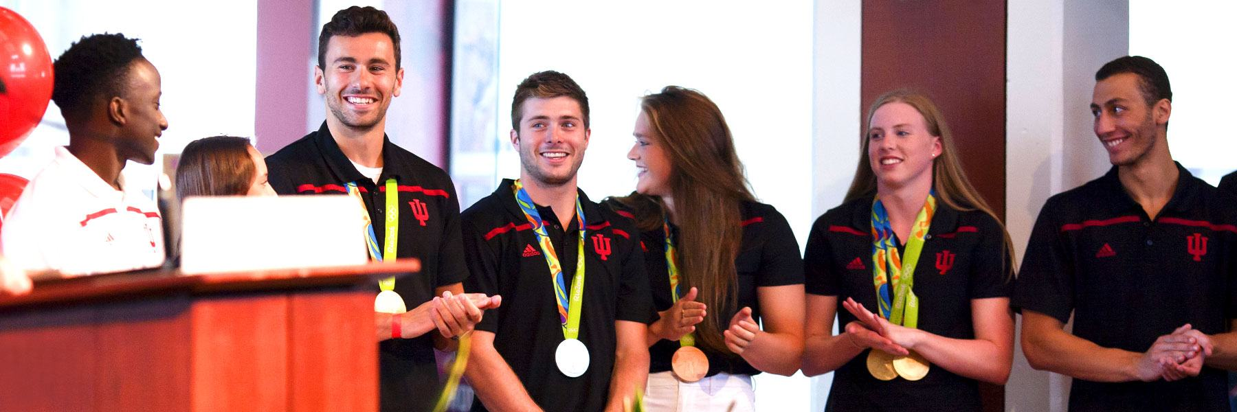 Student Olympic athletes at a reception