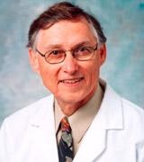 John E. Pless